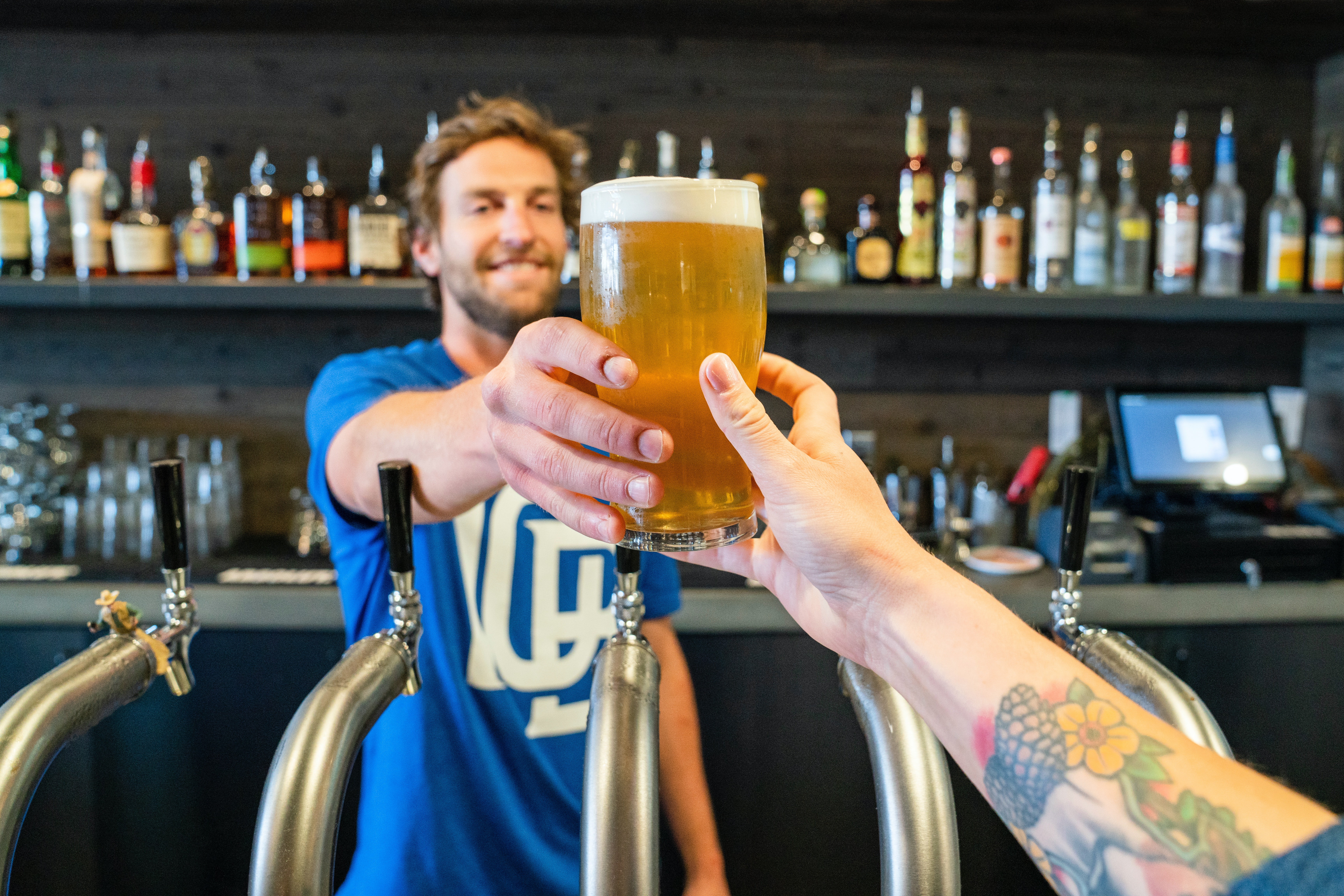 man-handing-a-person-a-glass-of-beer-1267323